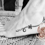 Polynesian women foot tattoo